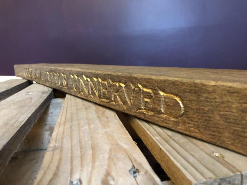 Oak and gilt lettered shelf